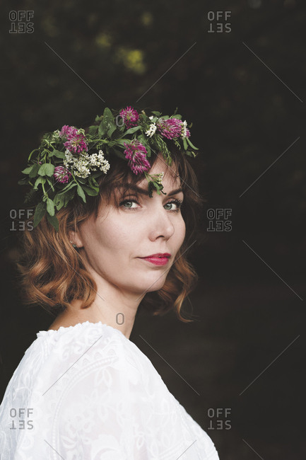 Portrait of woman with flower wreath on her head