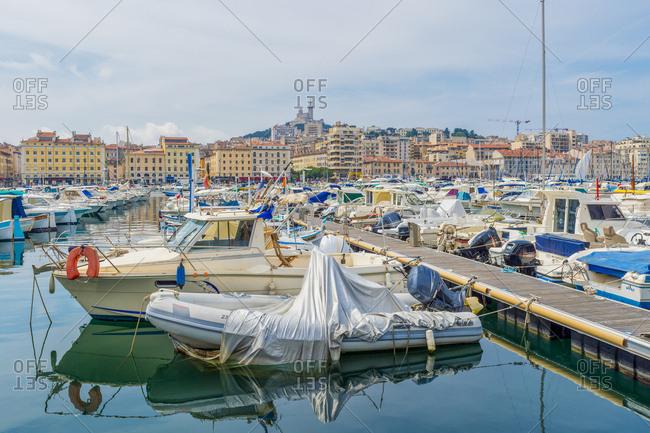 May 24, 2018: France- Provence-Alpes-Cote d'Azur- Marseille- Old Harbor and marina with Basilique Notre-Dame de la Garde