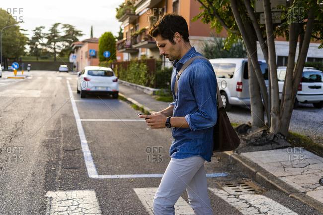 Man crossing street in the city