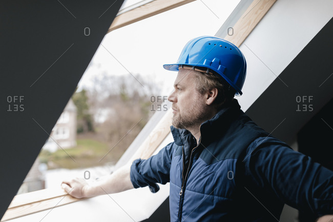 Architect looking out of window on a construction site