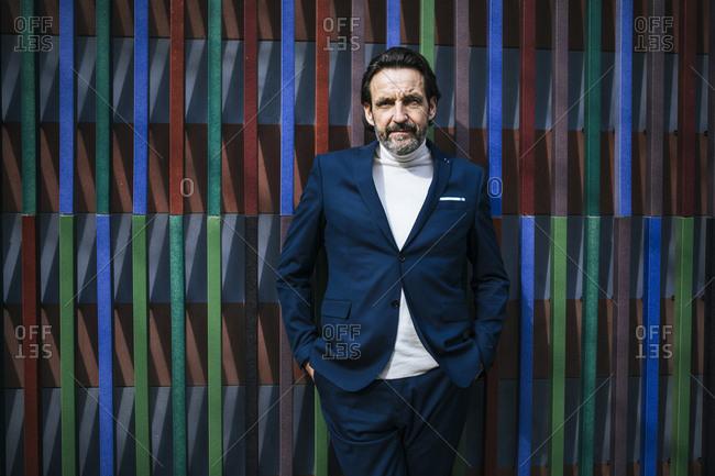 Portrait of mature businessman wearing blue suit