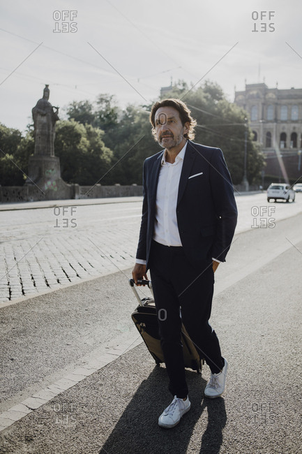 Businessman with trolley in the city