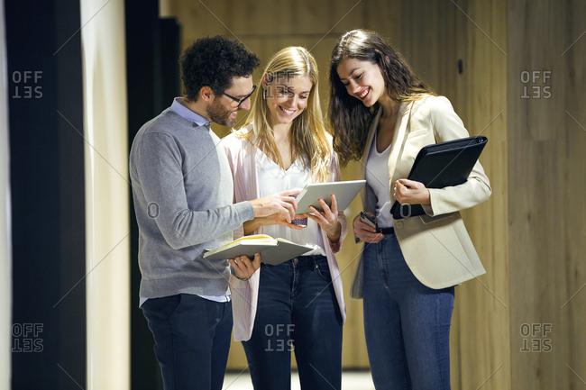 Three confident business people meeting on office floor