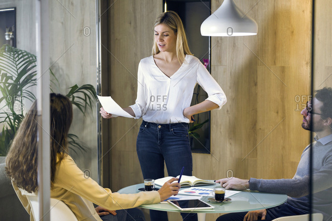 Young businesswoman leading a presentation in modern office