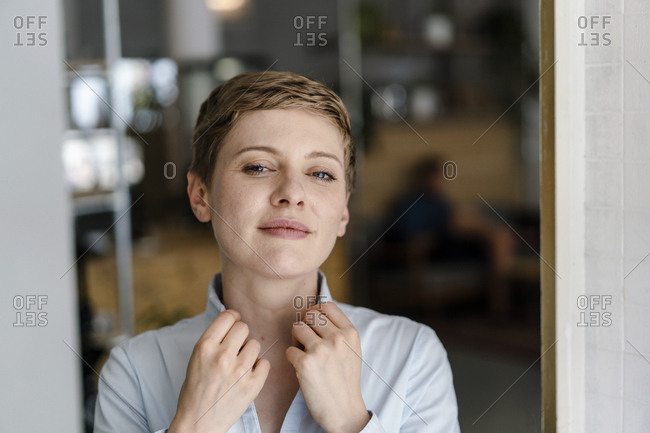 Portrait of a confident woman in a cafe