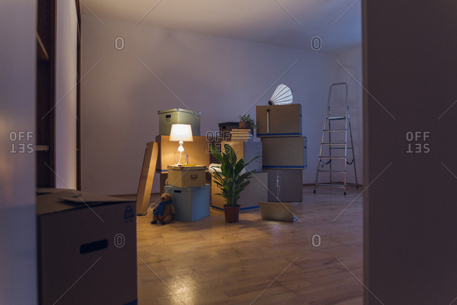 Cardboard boxes in an empty room in a new home