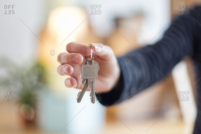 Close-up of man holding house key in new home