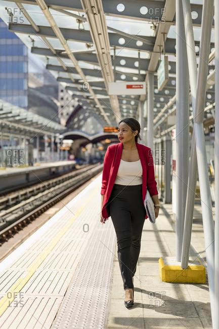 Businesswoman walking on platform- London- UK