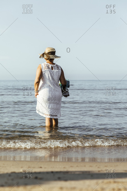 Senior woman wading in the sea- El Roc de Sant Gaieta- Spain