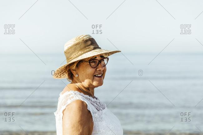 Portrait of content senior woman at the sea- El Roc de Sant Gaieta- Spain