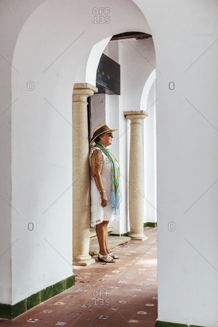 Senior tourist woman in a village- El Roc de Sant Gaieta- Spain