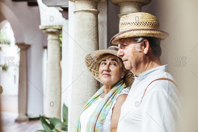 Senior tourist couple in a village- El Roc de Sant Gaieta- Spain