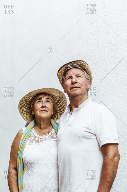 Portrait of senior couple looking up