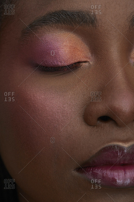 Portrait of African woman- closed eye- close-up- made up