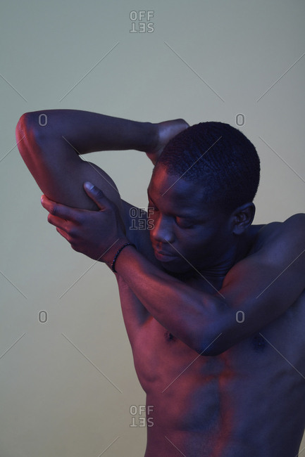 Portrait of African man- hand on his upper arm