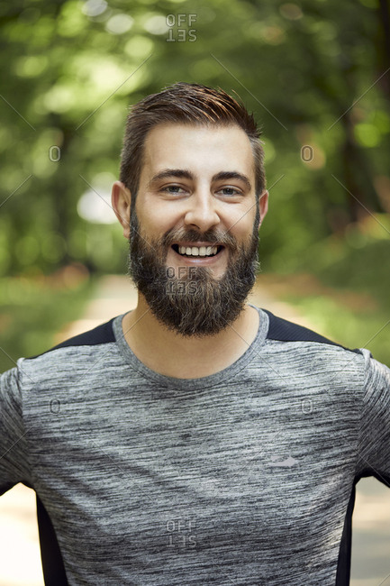 Portrait of smiling sporty man in forest