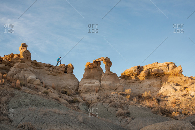 Hiking among Bisti/De-Na-Zin Wilderness hoodoo sandstone sculpture formations, New Mexico.