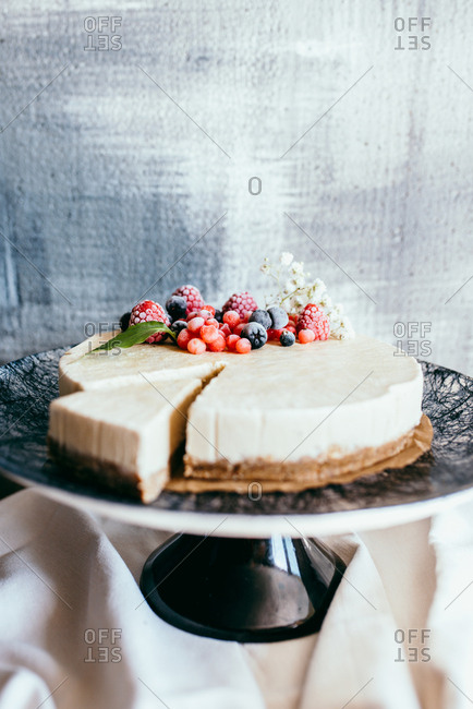 Beautiful holiday cheesecake with frozen berries as decoration
