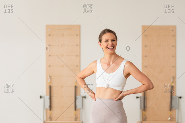 Portrait of pretty smiling woman standing at fitness studio.