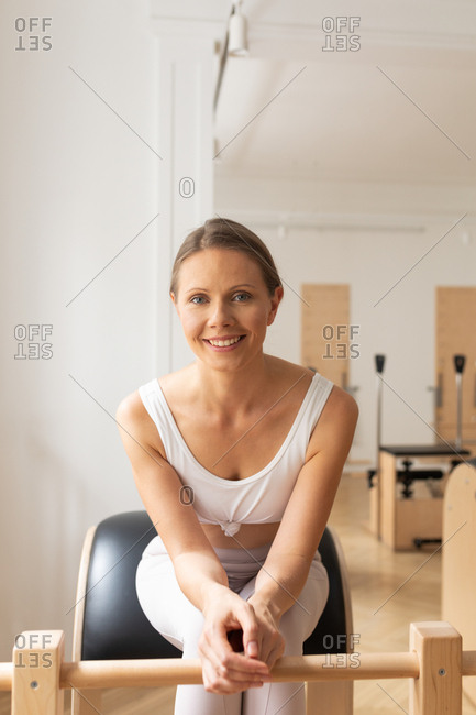 Portrait of a woman at pilates studio.