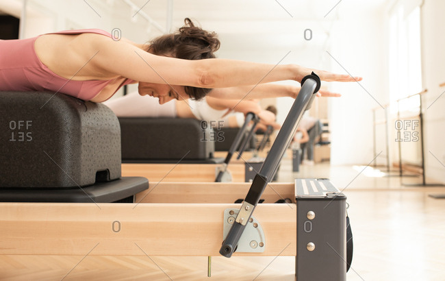 A woman doing reformer pilates training.