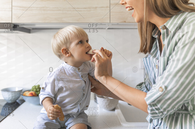 Smiling mother feeding her child.