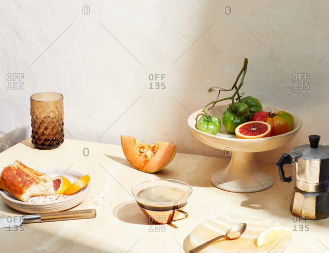 Breakfast table with fresh fruit and bread serve with coffee