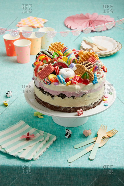 Birthday cake topped with a variety of candy and cookies