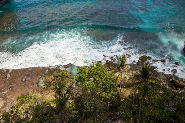 Aerial view over ways rolling into the coast of Bali