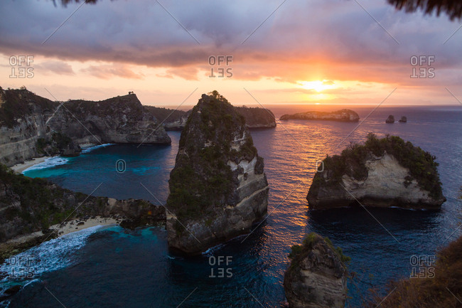 Beautiful sunrise over rock formations on the coast of Bali