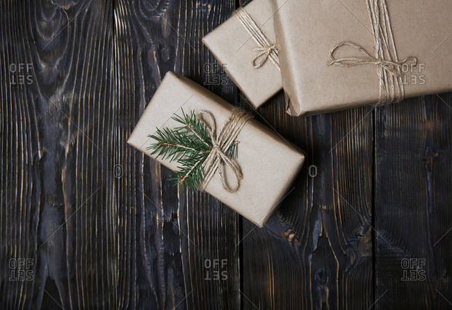 Christmas gift boxes on a wooden table