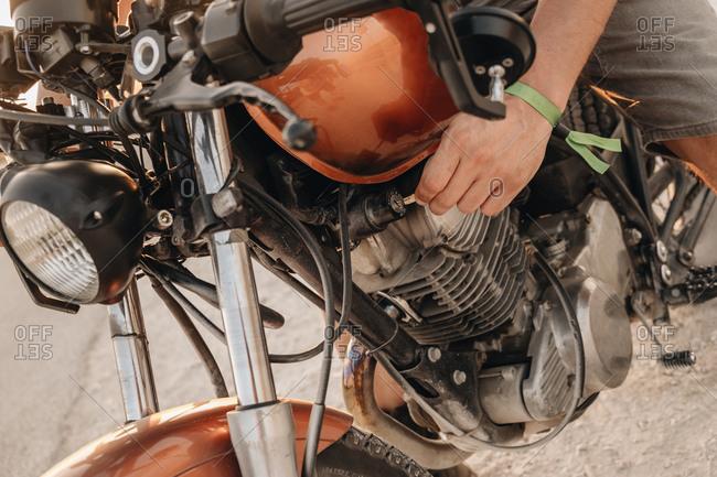 Male driving moto on asphalt