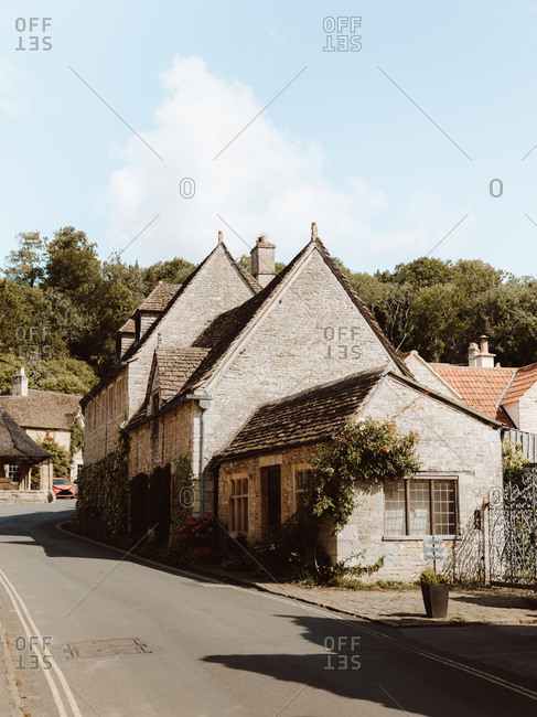 Picturesque view of medieval village Castle Combe with white and gray stone buildings in Dorset streets in United Kingdom
