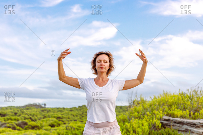Adult woman practicing martial arts in nature