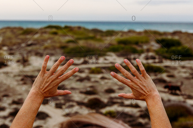 Crop person gesturing hands in nature