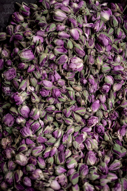 From above pile of delicate dried rose buds placed on stall on market in Marrakesh, Morocco