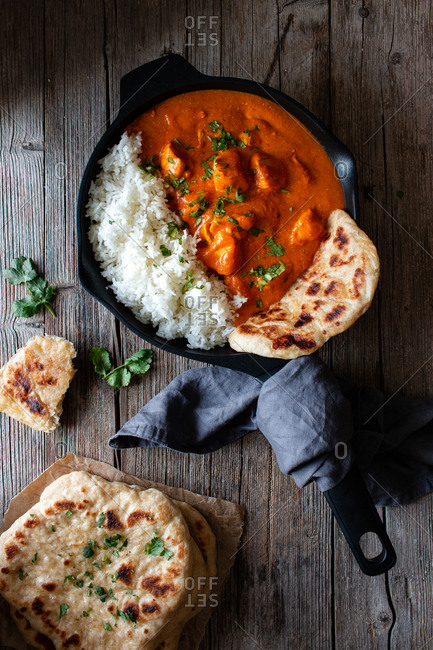 Close up of skillet full of delicious butter chicken and rice