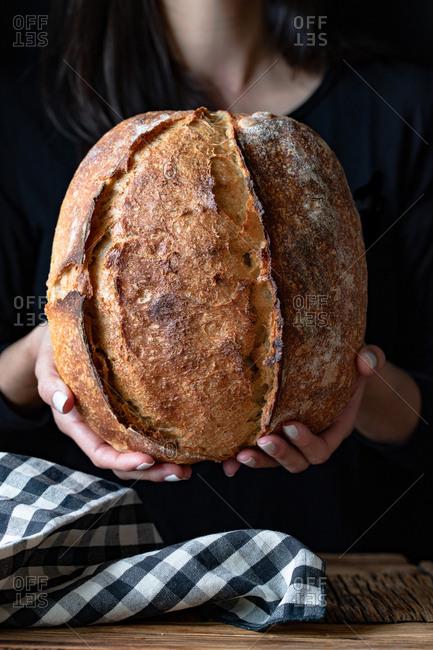 Unrecognizable person showing fresh bread