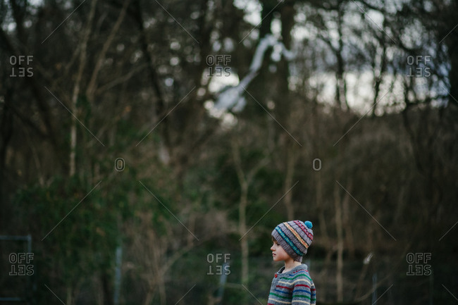 A portrait of a girl wearing a striped hat and a striped sweater
