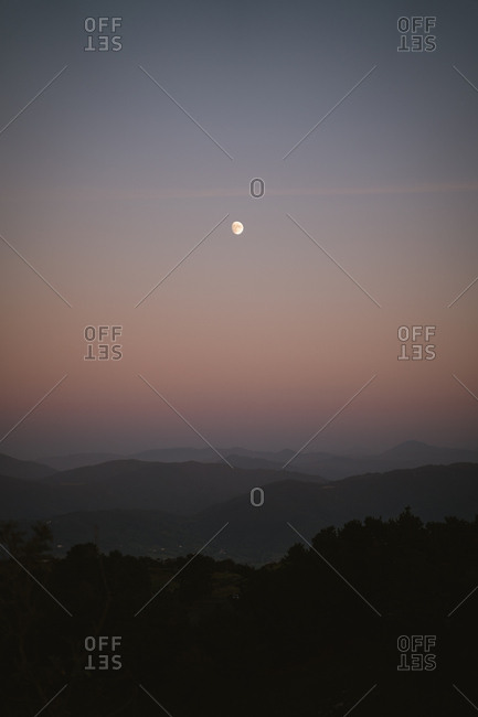 Moonrise over the mountains of basque country during twilight