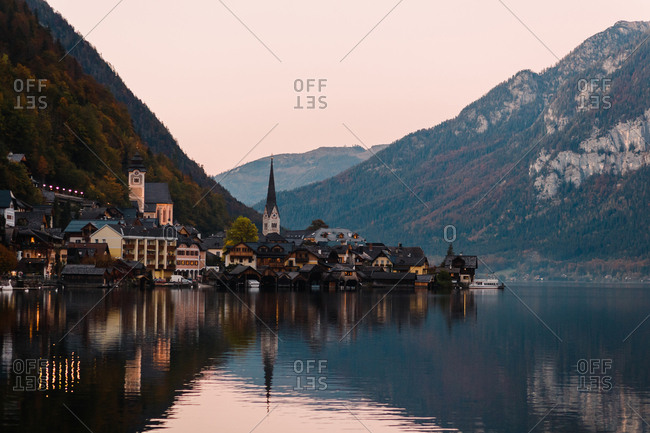 Evening Hallstatt is surrounded by the Alps and the crystal waters