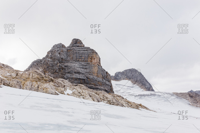 Snow-covered Dachstein Glacier and limestone ridges of the  Alps