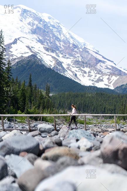 Hiker is crossing the bridge at Mt Rainier National Park
