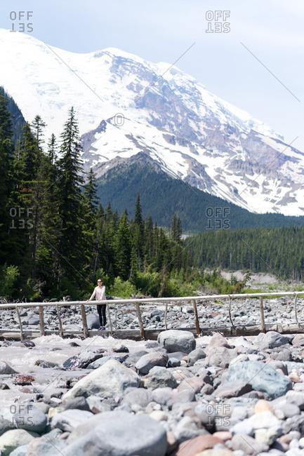 Hiker is standing on the bridge at Mt Rainier National Park