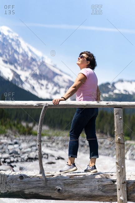 Senior lady enjoying the sunny day hiking in Washington