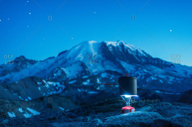 Cooking dinner on a small burner while backpacking in Washington
