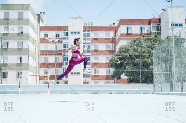 Colorful image of female athlete jumping on court