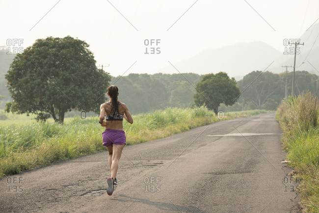 One runner on a road in Veracruz, Mexico.