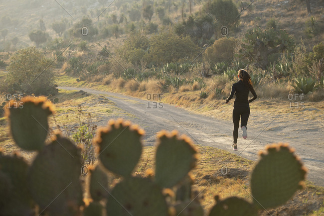 One runner on a dirt road Puebla, Mexico.