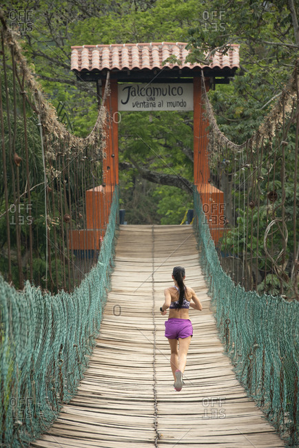 One runner on a wooden bridge in Veracruz, Mexico.